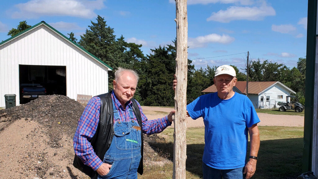 Pete Peters and Marvin Stumpf with a Flag Pole at Alkali Station