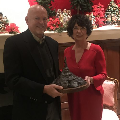 Sculptor David Biehl presenting Rhonda Seacrest her Chimney Rock sculpture